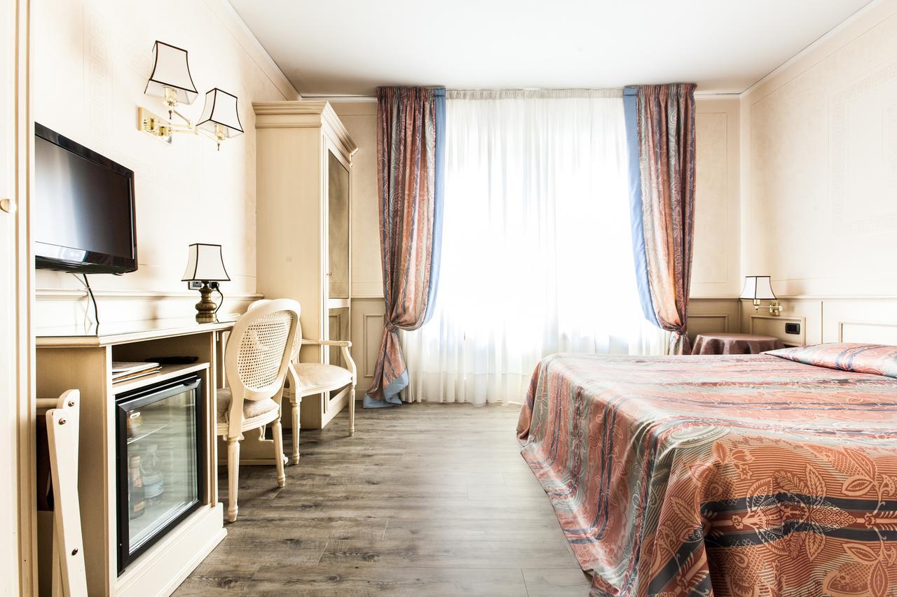 Комната в отеле San Luca